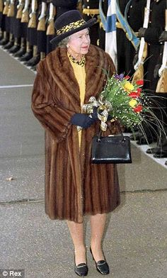 In Russia, in fur. The Soviet Union has collapsed, but the trusty slip-on is eternal. Die Queen, Hm The Queen, Royal Queen, Her Majesty The Queen, Save The Queen, Queen Hat, Queen Outfit, Isabel Ii, Casa Real
