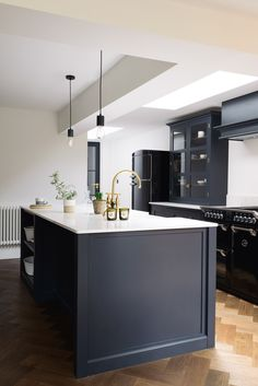 This beautiful black range cooker works perfectly with our Shaker cupboards painted in 'Pantry Blue' with Bella Brass hardware
