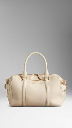 a51e22d599b1 The Burberry Bee Bag in Grainy Leather - A bowling bag in grainy leather.  The bag features a double-layered construction with concealed wing pockets  lined ...