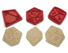 Each set of Critical Hit Cookie Cutters comes with six of the most random cookie cutters you'll ever meet. You get a d4, d6, d8, d10, d12, and d20.