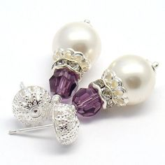 A beautiful Victorian Style pair of earrings with round  White Swarovski Pearls(10 mm), faceted round Amethyst Swarovski Crystal and Silver Plated filigree post earwires.  These earrings measures abou