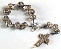 Beads are half rounds of rock crystal with interior painting held together in frames  Rosary and Cross  16th century, Italy  Rock crystal, painted and gilded, with pearls and gilded silver mounts  Museo Civico d'Arte Antica e Palazz