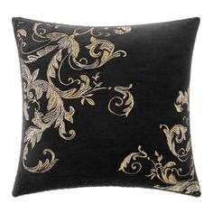 The Croscill Selena square pillow is embroidered with an exquisite silver and gold scroll motif over rich mink velvet.
