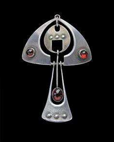 Silver pendant/brooch. ANDREAS ODENWALD  Secessionist Brooch.   Silver, Garnet. H: 4.4 cm (1.73 in)  W: 2.8 cm (1.1 in) German, c.1900