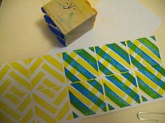 Foam stamps.  Small 2 inch block from craft store and sticky foam elements from Dollar store. Use two sides of block, contrasting colors,two different designs, layering to create mixing.  Fun.