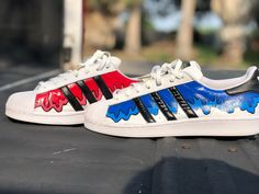 Custom Adidas Superstars All hand painted Customized by on IG Comes with leather laces Sz Custom Painted Shoes, Custom Shoes, Adidas Superstar, Cool Adidas Shoes, Painted Sneakers, Superstars Shoes, Old Shoes, Disney Shoes, Custom Sneakers