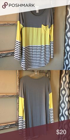 "B.E. Stage multi color tunic-BRAND NEW! Brand new boutique B.E. stage multi colored tunic in gray, yellow, and black and white striped.  Size Large.  Fits True to Size.  Long enough to wear with leggings and I'm 5'6"".  Super cute for this fall and winter!! B.E. Stage Tops Tunics"