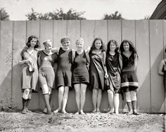 Teenage girls in this time period wore shorter more revealing things, like the swimsuits in this picture. On the far right and far left are less-bad girls, wearing stockings and skirted suits, but still BARE ARMS on the right.
