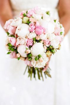 Hand held posy bouquet featuring peonies, David Austin roses and spray roses - Image by Calli B Photography