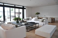 open plan living dining with simple white furniture and black accessories - mb residence - Briggs Edward Solomon
