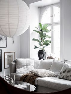 I love a home that's well accessorised. Accessories can make such a big difference and can give a home character and personality. The crisp white floors and walls in this Swedish home could easily give this space an almost clinical … Continue reading → Living Room Interior, Living Room Decor, Interior Exterior, Interior Design, Ikea Sofa, Colorful Pillows, White Houses, Grey Walls, Interior Inspiration