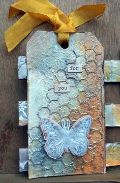 Wendy Vecchi butterfly, love it, gesso, modelling paste, stencils honeycomb and dyan reavely, distress inks, crackle and utee Mixed Media.