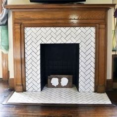before & after herringbone tile fireplace renovation in a 1918 bungalow. This simply THE BEST looking tile-work around a fireplace that I've ever seen. Subway Tile Fireplace, Tile Around Fireplace, Herringbone Fireplace, Fireplace Tile Surround, Craftsman Fireplace, Black Fireplace, Herringbone Tile, Farmhouse Fireplace, Home Fireplace