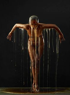 """Blake Little from """"Preservation"""" series where models are coated in honey. which mimics the appearance of amber"""