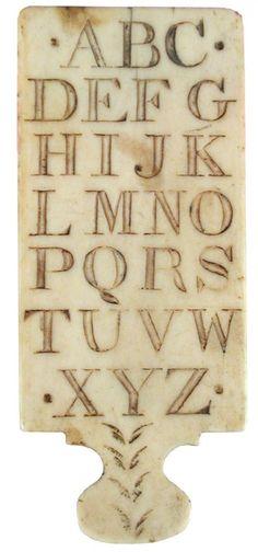 A rare ivory alphabet hornbook circa 1800,