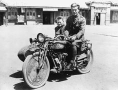 Sgt. McIntosh and Mr. Harrison Sitting on an Indian Motorcycle.