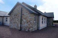 90% Tipperary Brown & 10% Tipperary Blue Sandstone - Coolestone Stone Importers Suppliers Masonry Tyrone Northern Ireland Blue Granite, Double Front Doors, Stone Masonry, House Windows, Northern Ireland, Bungalow, Modern Design, Outdoor Structures, Brown