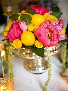 Bright lemons off-set the lush peonies and teeny roses in this fun centerpiece.