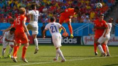 Leroy Fer of the Netherlands scores his team's first goal on a header during the 2014 FIFA World Cup Brazil Group B match between the Netherlands and Chile