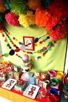 Sesame Street parties - I like the circle streamers and colorful pom-poms.  Both cheap and easy ideas.