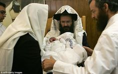 The ultra-Orthodox practice of metzitzah b'peh requires a practitioner to orally suck the baby's penis to 'cleanse' the open wound following its circumcision, making them susceptible to the virus (file photo)