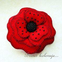 red poppy .... felt flower brooch by Anna Zaprzelska ... buttonhole stitched edges ... black seed beads ... gorgeous!