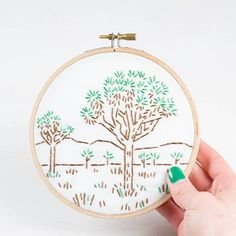 It's officially summer now so that means hiking camping and eating half your weight in smores. If you visit a National Park this year (they are turning 100!) you can commemorate the trip with a stitched version of the iconic landscape. I have the 6 most popular parks in my shop right now. This little beauty here is Joshua Tree which I got to visit 2 years ago. I loved the funky trees!