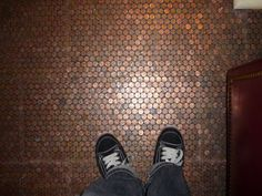 Using pennies to tile your floor. So cool