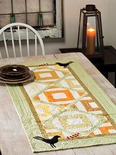 "Update a primitive idea with vibrant solids to create a modern country masterpiece. The paper-piecing method is used in this autumn-hued runner. This e-pattern was originally published in Simply Solids. Size: 22 1/4"" x 50 1/2"". Block Size: 9"" x 9"". Skill Level: Intermediate"