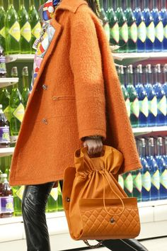 Good coat is an essential i.e. this bright orange Chanel one!