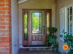"Classic Entry Door with 2 side lights. Therma-Tru Fiber Classic Mahogany grain factory stained Mahogany model FCM914 -3/4 glass Concorde design. EMtouch Emtek handle set. 5 foot opening - replaced 2 x 30"" doors. Installed in Mission Viejo, CA home."