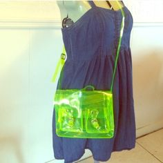 "90s Clear PVC Plastic Neon Green Crossbody Purse A super cute 90s style purse. This is a bright neon yellow/green transparent crossbody bag with chrome magnetic closures and an adjustable strap. It's roomy and has 2 front pockets for extra storage. It has been used but is in great condition! Very easy to keep clean with mild soap and water. Measures 10"" (length) by 2 1/2"" (width) by 10"" (height), with a strap drop of 26"". Offers welcome! Bags Crossbody Bags"