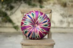 Fuchsia multicolored ikat velvet round pillow by originalboutique, $38.50  So beautiful!  I love it.  Unfortunately, so would my cats.  Maybe I could just hang it on the wall?