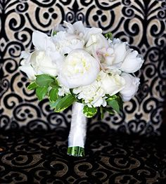 White flowers and greenery make for a beautiful bridal bouquet.