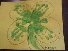 Cute St. Patrick's Day handprint four-leaf clover