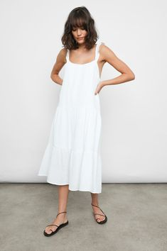 """DETAILS   Lightweight, double gauze cotton, sleeveless, lined, crisp white midi dress featuring scoop neckline, swingy fit, shoulder straps with ruffle detail, and flowy tiered skirt. This pretty pullover dress features feminine details for an effortless, elevated look. 100% Cotton. Imported. CARE   Machine Wash Cold Separately. Gentle Cycle. Do Not Bleach. Tumble Dry Low. Cool Iron If Needed. Or Dry Clean. FIT   Recommend ordering true to size. Front Body Length: 38 1/4"""" (Measured from Small) M Gauze Clothing, White Capris, Gauze Dress, White Midi Dress, Tiered Dress, Feminine, Model, Clothes, Dresses"""