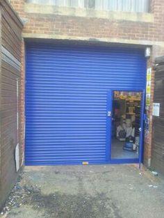 Roller shutter with wicket gate. www.worcesterdoors.co.uk
