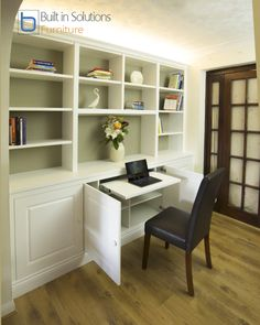 These built in Cabinets and Shelving with raised panel doors feature a pull out desk in the central cabinets, this space is enough space for a laptop and occasional paperwork