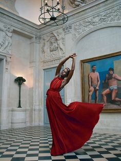 Muse at the Museum A vision in scarlet, the actress dances in Paris's Musee Picasso. Valentino Haute Couture velvet dress and headpiece.
