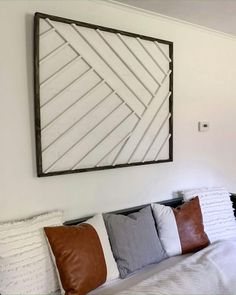 Check out how to make your own West Elm knockoff scrap wood wall art for free (or less than $25 if you don't have the scraps).