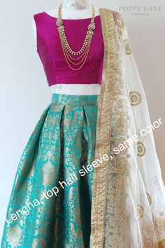 The Stylish And Elegant Lehenga Choli In Teal Green Colour Looks Stunning And Gorgeous With Trendy And Fashionable Raw Silk Brocade Fabric Looks Extremely Attractive And Can Add Charm To Any Occasion. Lehenga Designs, Indian Gowns Dresses, Pakistani Dresses, Brocade Dresses, Pakistani Bridal, Indian Bridal, Indian Attire, Indian Wear, India Fashion