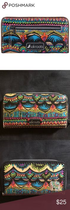 """Sakroots large zip around wallet Brighten up your look with the sakroots by The Sak Artist Circle Slim Wallet. Featuring a striking multicolor bird print accented by clear sequin detailing, this wallet is equal parts whimsical and practical.   Product Features Main zipper closure Back slit pocket Detailed Product Description Inside features 16 credit card slots, 2 bill slots, 2 open compartments and 1 zipper pocket Product Specifications Exterior Dimensions: 8"""" x 4"""" x .75""""  ~FREE GIFT…"""