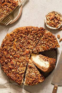You'll go nuts for a heavenly slice of Pecan Pie Cheesecake with a homemade pecan graham cracker crust that combines two classic desserts into one sinful bite.
