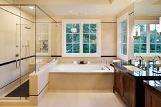 Great serene limestone look.  Love the stain on the cabinets and black marble top