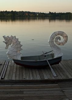 I need a back yard with a lake & a parasol...    Seahorse Boat by Eric Frommer . Equinox at Green Lake