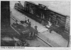 "The only verified photo of a Tiger during the Uprising. The photo was taken by Jan Moor-Jankowski. The caption on the photo is not entirely correct. The Tiger, from 9./SS-Pz.Rgt. 3 ""Totenkopf"", is actually on ul. Jana Pankiewicza near its intersection with Aleje Jerozolimskie. I believe this photo was taken on 3 August 1944."