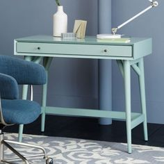 Mint may be considered green, but it's really a blend of blue and green. That means mint furniture, like this mid-century modern desk, looks right at home in an otherwise all-blue room.