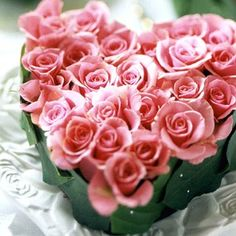 Rose Heart Arrangement ~ A shaped block of wet floral foam is covered with rosebuds. Green leaves are pinned to the sides to cover the remaining foam.
