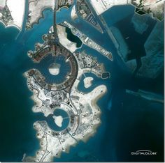 Flying high over The Pearl, Doha, Qatar   This is a natural color, 2 meter DigitalGlobe satellite image featuring The Pearl, a man-made island near Doha, Qatar.