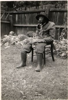 Mid 1950s. Note the cat on his lap. From the submitter: I hooked a coat hanger over his collar to form shoulders, and newspaper stuffed into his trousers.